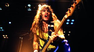 A photograph of Steve Harris on stage in 1987
