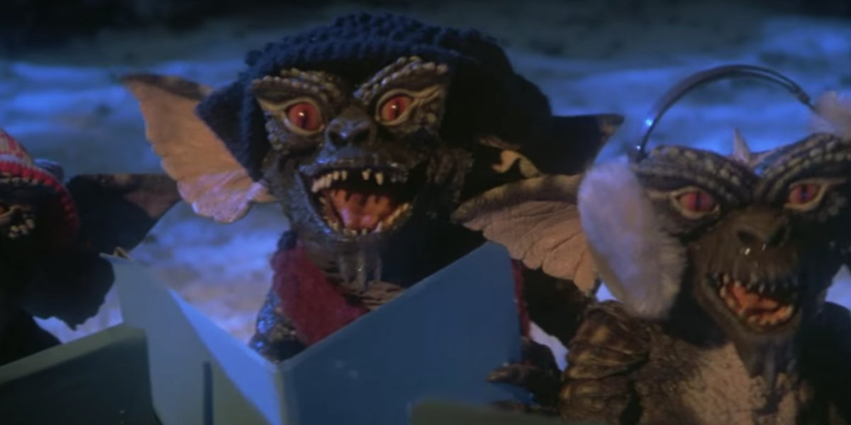 Little green monsters sing Christmas Carols in Gremlins