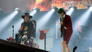 Axl Rose and Angus Young of AC/DC onstage in Lisbon