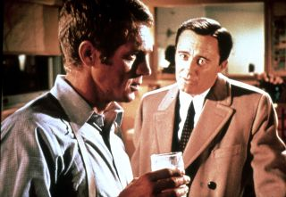 Steve McQueen is suspicious of Robert Vaughn