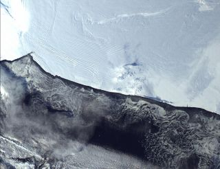 The Ross Ice Shelf is the world's largest ice shelf and an enormous raft-like extension of the West Antarctic Ice Sheet.