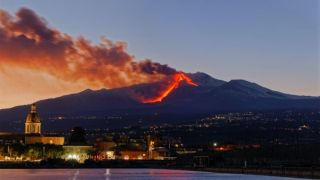 Red lava streams down the side of Mount Etna in Sicily.