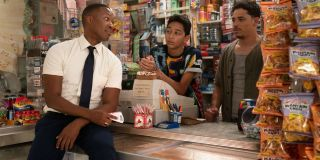 Corey Hawkins Gregory Diaz IV and Anthony Ramos hang out at the counter in In The Heights.