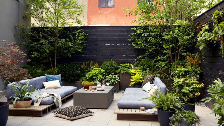 Urban garden in New York with plants and outdoor furniture