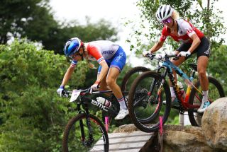 Pauline Ferrand Prevot of Team France and Jolanda Neff of Team Switzerland during the women's cross-country event at the Tokyo Olympic Games