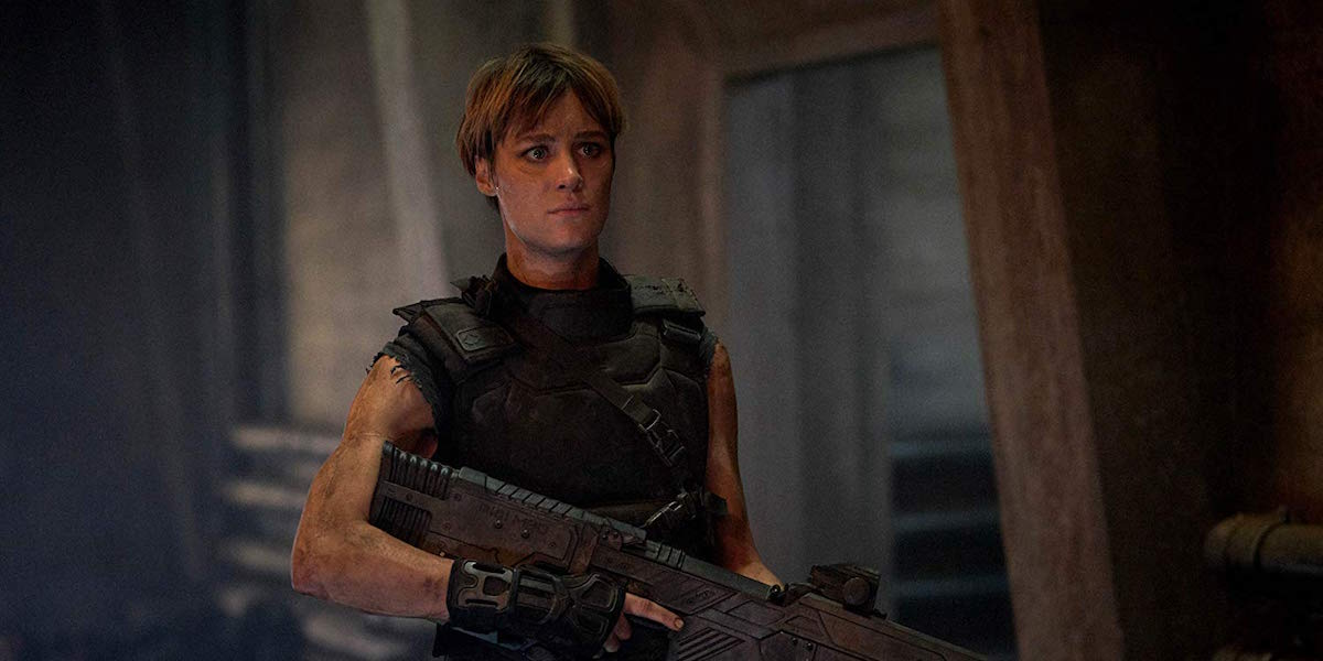 Mackenzie Davis as Grace holding gun in Terminator: Dark Fate