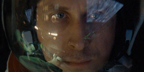 Ryan Gosling as Neil Armstrong wearing a helmet in First Man 2018
