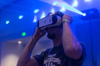 Guy tries virtual glasses headset during VRLA Expo, virtual reality exposition, event at the Los Angeles Convention Center in Los Angeles in August 2015.