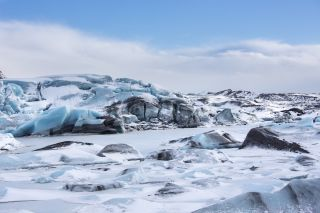 Long ago, glaciers may have bulldozed away hundreds of millions of years of sedimentary rock. Shown here, ice blocks of Svinafellsjokull glacier in Iceland.