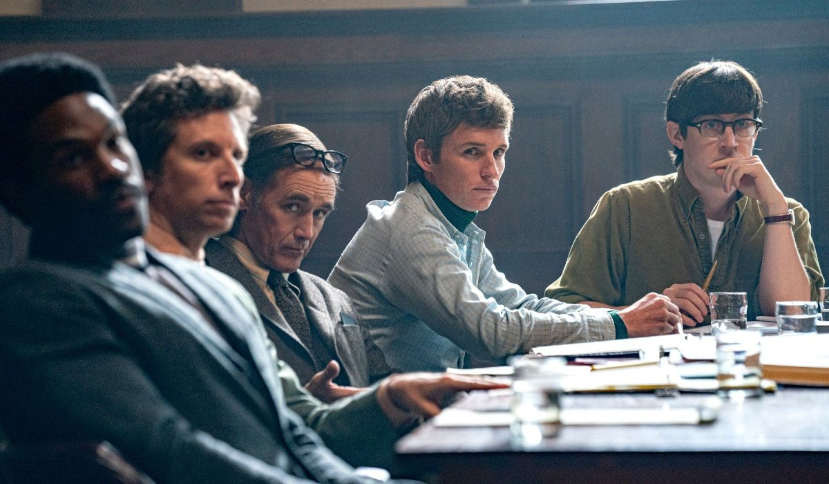 The Trial of The Chicago 7 Yahya-Abdul Mateen II, Mark Rylance, and Eddie Redmayne sit together in court