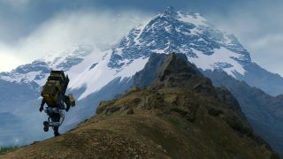 Sam Bridges hikes up to a mountain summit in Death Stranding.