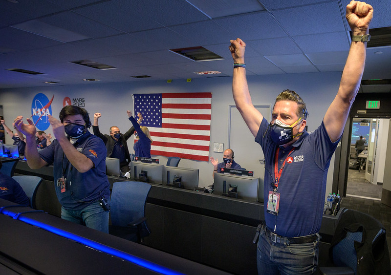 Members of NASA's Perseverance rover team react in mission control at NASA's Jet Propulsion Laboratory in Southern California on Feb. 18, 2021, after receiving confirmation that the spacecraft successfully touched down on Mars.