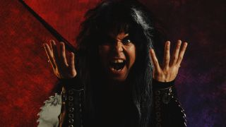 A close-up of Blackie Lawless with his hands raised, snarling