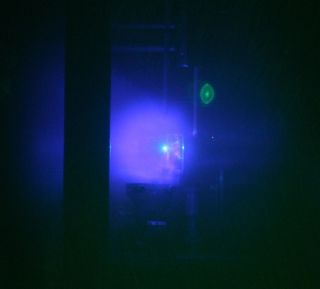Physicists have created an explosion in the lab that mimics supernovas. Shown here, the light emitted as the shock wave of plasma expanded outward.