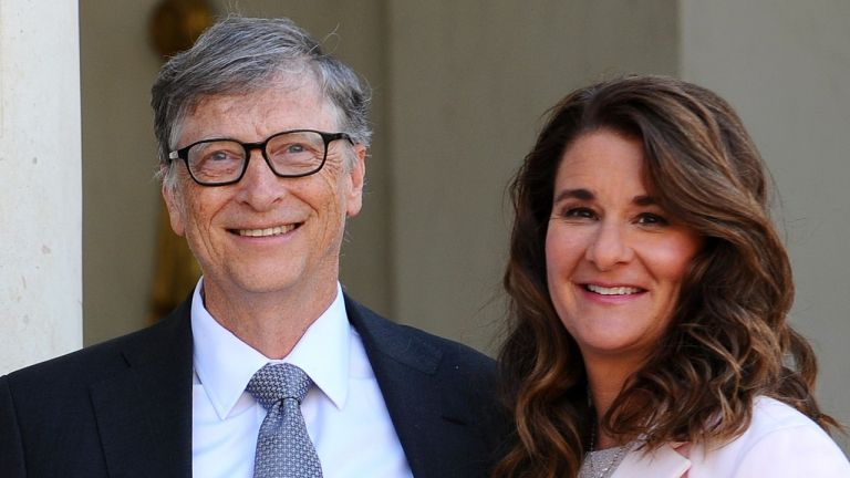 Bill and Melinda Gates pose in front of the Elysee Palace before receiving the award of Commander of the Legion of Honor by French President Francois Hollande on April 21, 2017 in Paris, France