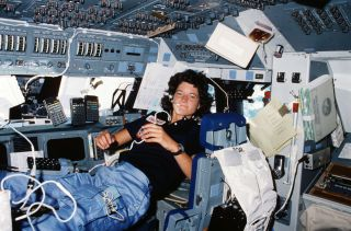 Sally Ride floats in space on STS-7 mission.