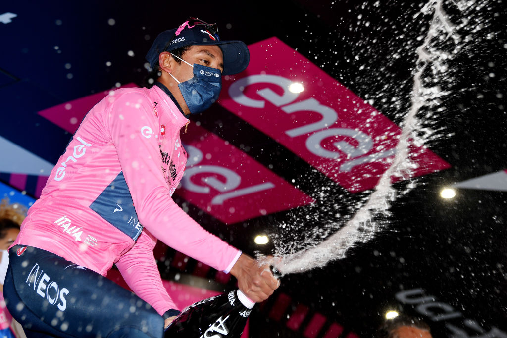 CORTINA DAMPEZZO ITALY MAY 24 2of Colombia and Team INEOS Grenadiers Pink Leader Jersey celebrates at podium during the 104th Giro dItalia 2021 Stage 16 a 153km stage shortened due to bad weather conditions from Sacile to Cortina dAmpezzo 1210m Champagne girodiitalia Giro on May 24 2021 in Cortina dAmpezzo Italy Photo by Stuart FranklinGetty Images