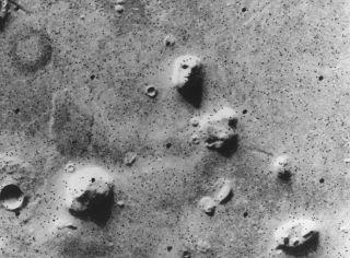 face on mars image taken by viking 1 orbiter in 1976.