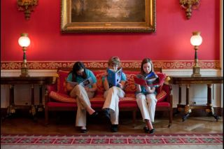Students, from left, Gaby Dempsey, 12, Kate Murray, 13, and Mackenzie Grewell, 13, read in the Red Room of the White House after setting up their science fair exhibit, Feb. 6, 2012. The three girls, part of the Flying Monkeys First Lego League Team from A