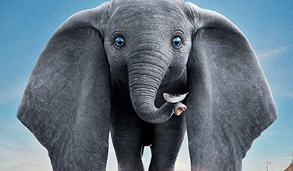 Dumbo holding a feather on his trunk