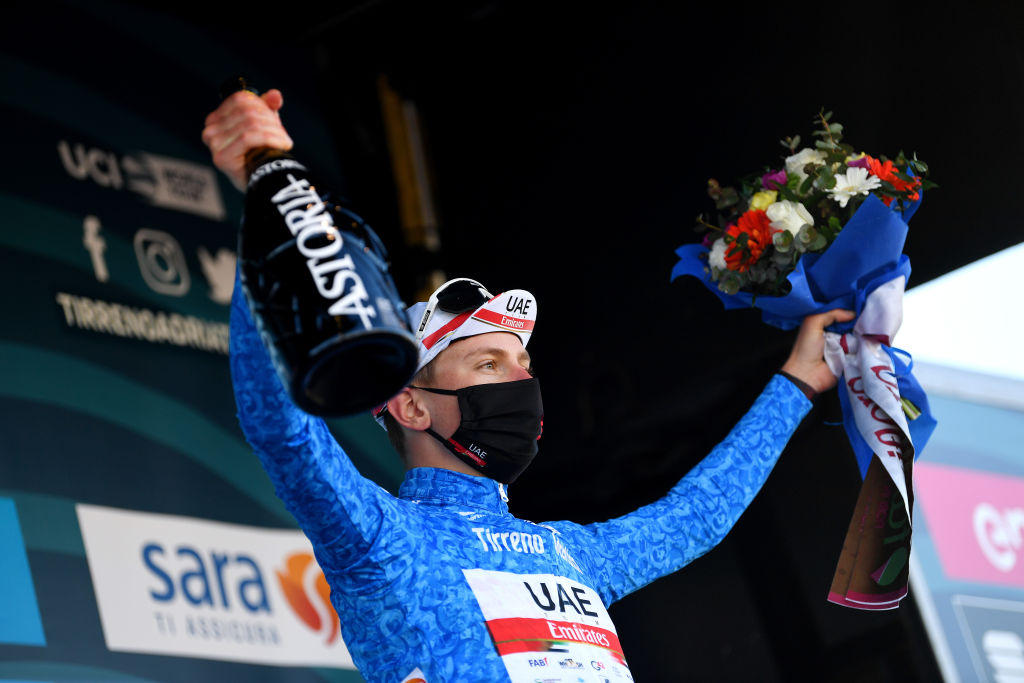 LIDODIFERMO ITALY MARCH 15 Podium Tadej Pogacar of Slovenia and UAE Team Emirates Blue Leader Jersey Celebration during the 56th TirrenoAdriatico 2021 Stage 6 a 169km stage from Castelraimondo to Lido di Fermo Mask Covid safety measures Flowers TirrenoAdriatico on March 15 2021 in Lido di Fermo Italy Photo by Tim de WaeleGetty Images