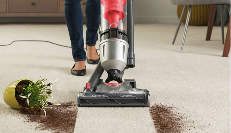 how to vacuum up soil off a carpet