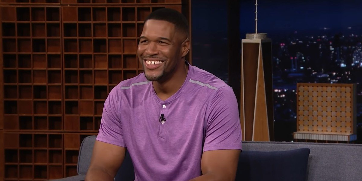 Michael Strahan's signature smile showing up on The Tonight Show with Jimmy Fallon