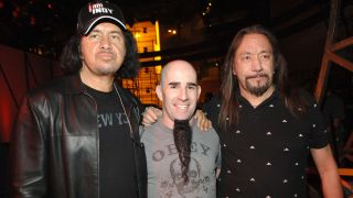 A picture of Scott Ian with Gene Simons and Ace Frehley in 2006
