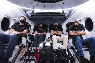 "From left to right: ESA astronaut Thomas Pesquet, NASA astronaut Megan McArthur, NASA astronaut Shane Kimbrough and JAXA astronaut Akihiko Hoshide sit inside the SpaceX Crew Dragon ""Endeavour."""