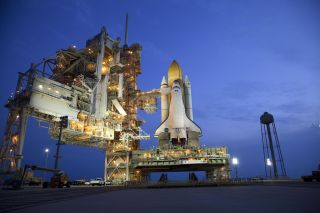Space shuttle Atlantis stands on Launch Pad 39A at NASA's Kennedy Space Center in Florida, where it is set to liftoff on STS-135, the final shuttle mission.