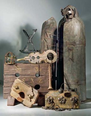 Several torture devices, including an iron maiden, the human-sized box on the right.