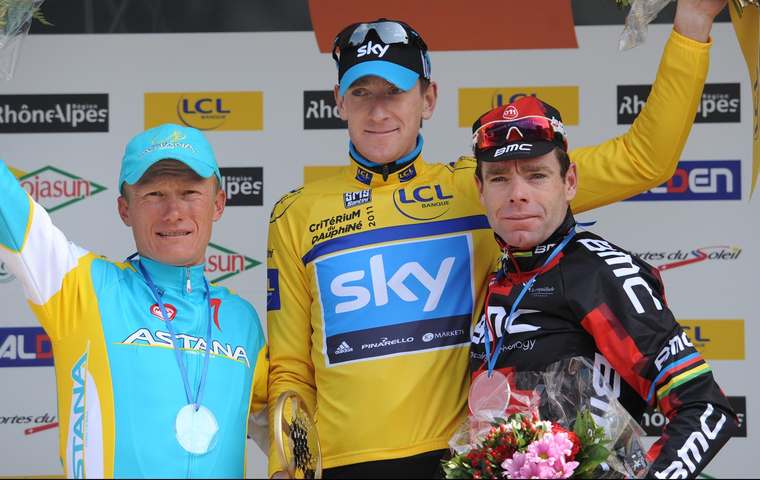 Bradley Wiggins top podium, with Alexandre Vinokourov (third) and Cadel Evans (second), Criterium du Dauphine 2011, stage seven