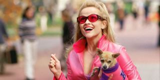 Reese Witherspoon carries Bruiser the dog on campus in Legally Blonde.