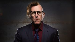 A portrait of Maynard James Keenan looking into the camera