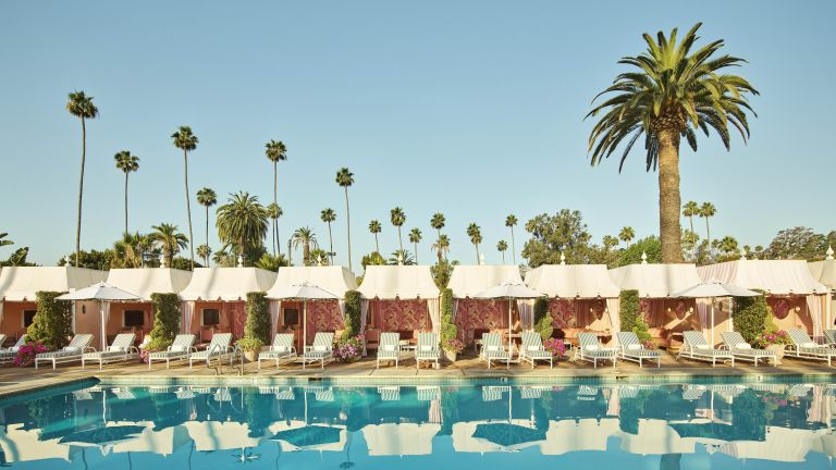 The Beverly Hills Hotel poolside with swimming pool and palm trees