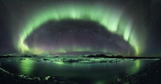 'A Starry Night in Iceland' by Stephane Vetter (http://www.nuitsacrees.fr/). First prize in the Beauty of the Night Sky category. An aurora dances over Iceland.