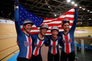 Lily Williams, Jen Valente, Emma White and Chloe Dygert celebrate their gold-medal-winning ride in the team pursuit at the 2020 UCI Track World Championships in Berlin, Germany