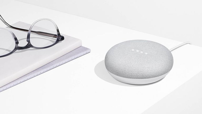 google home mini with smart assistant by John Lewis & Partners