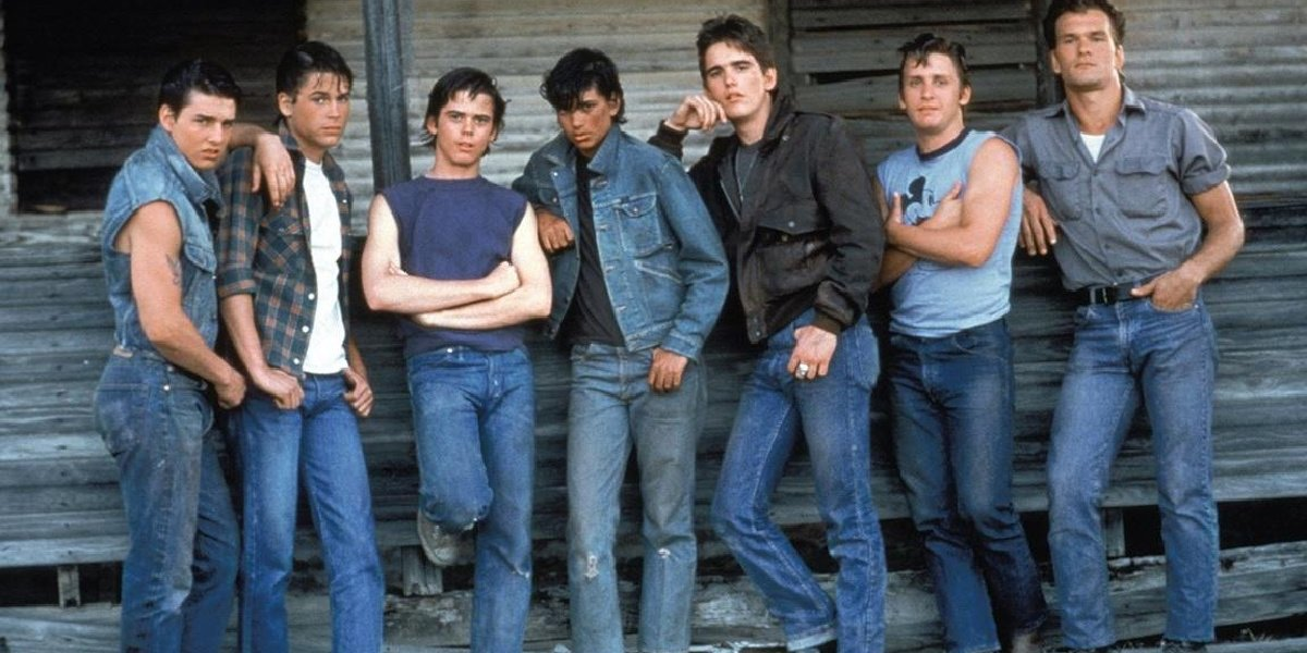 Ralph Macchio alongside his cast of The Outsiders.