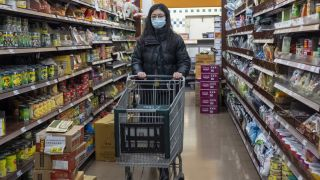 A woman wearing a surgical mask shops at a grocery store in Cupertino, California, on Jan. 23, 2020.