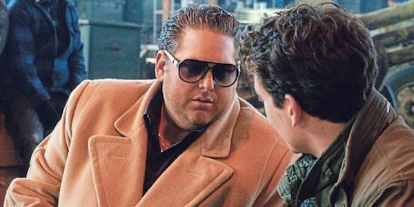 Jonah Hill in a jacket and sunglasses in War Dogs