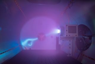 A Phase Four plasma thruster in testing. The small thrusters could one day power interplanetary spacecraft.