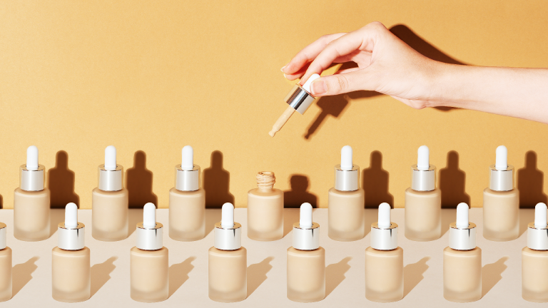 best lightweight foundation bottled on a yellow background