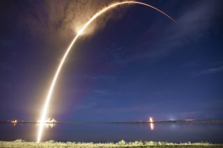 A SpaceX Falcon 9 rocket streaks across the night sky on Sept. 7, 2014 in this long-exposure view of the AsiaSat 6 satellite launch from Cape Canaveral Air Force Station in Florida.