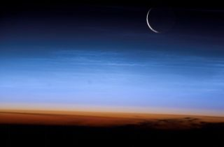This photo of Earth and the moon was taken by an astronaut at the International Space Station in 2003.