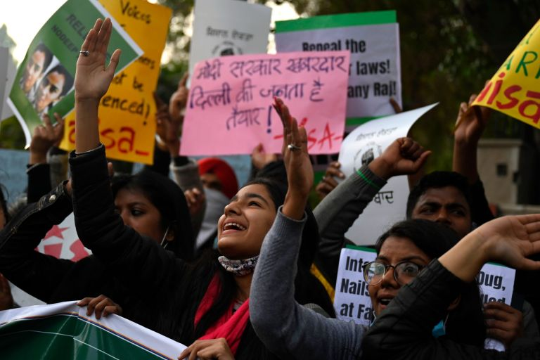 Demonstrators take part in a march organised in support of farmers protesting against the central governments recent agricultural reforms in New Delhi on February 3, 2021.