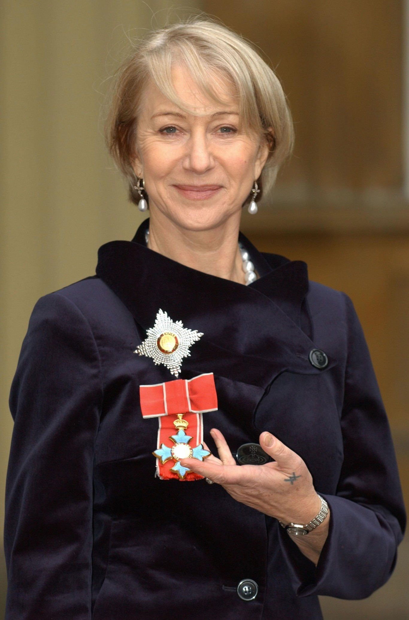 Helen Mirren after being invested as a Dame from the Prince of Wales during a ceremony held at Buckingham Palace in 2003