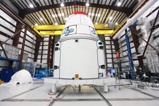 SpaceX's Dragon Spacecraft With Solar Array Fairings in Hangar