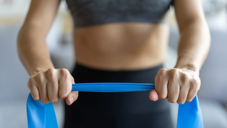 Woman gripping a resistance band