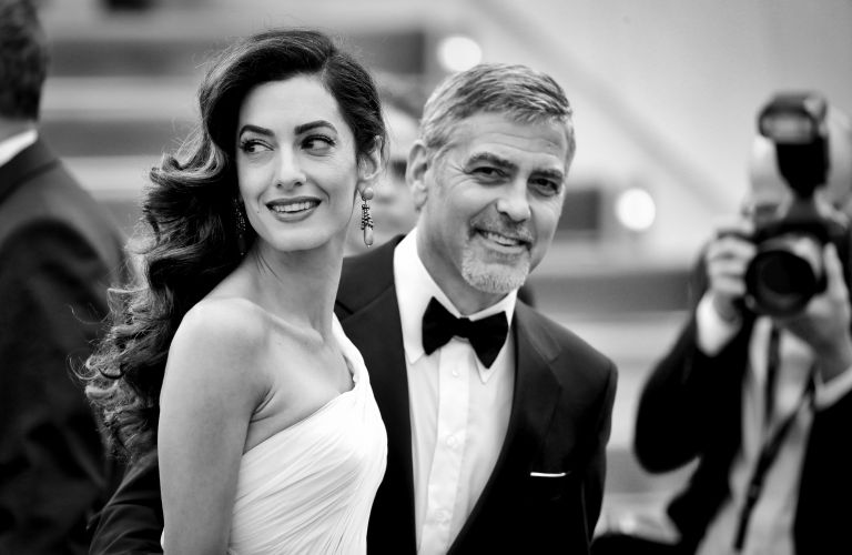 George and Amal Clooney in black and white